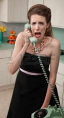 9610217-young-caucasian-woman-in-a-kitchen-weeps-while-on-the-phone